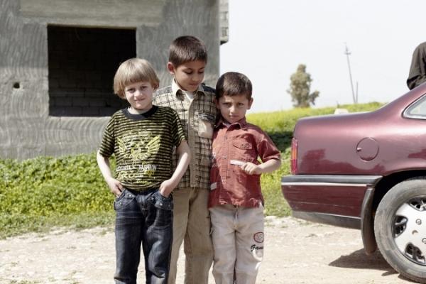 Boys, brothers and a friend, close to Şalāḩ ad Dīn, A.R.Kurdistan 2010