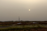 Picnic at sunset and oil field